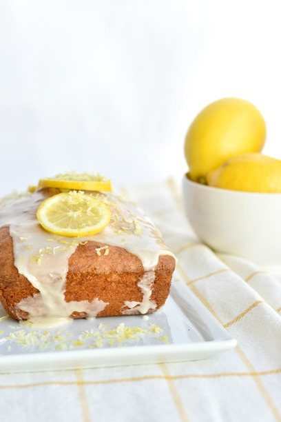Gluten Free Lemon Cake on a plate with lemons