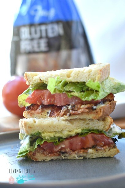 Gluten Free BLT Sandwich cut in half on a plate