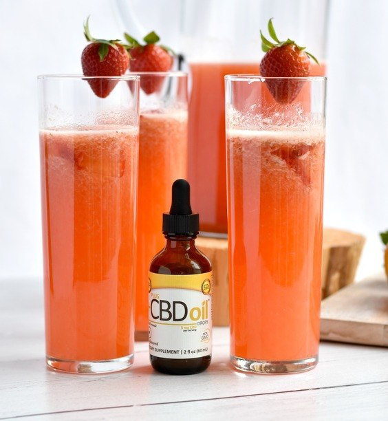glasses of cbd strawberry lemonade with cbd drops