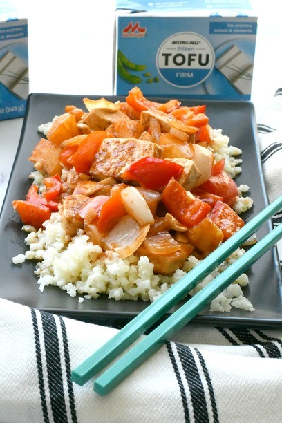 vegan sweet and sour tofu on a plate with chopsticks