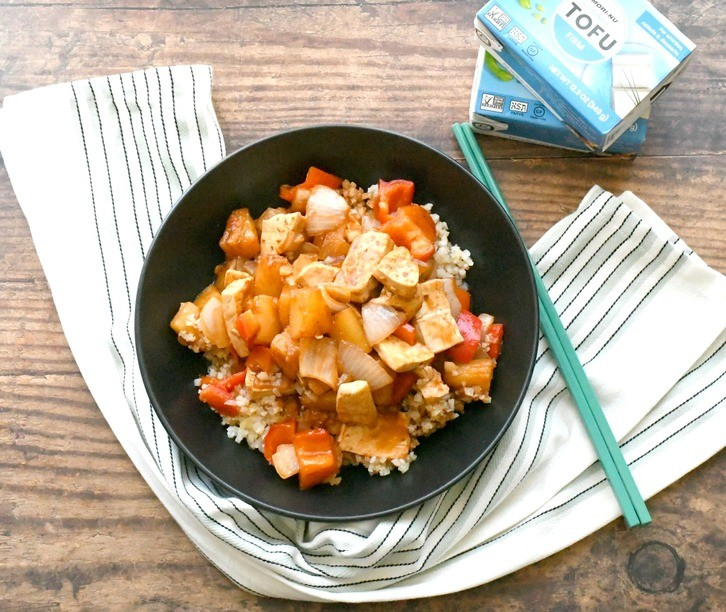 vegan sweet and sour tofu recipe in a bowl with a towel
