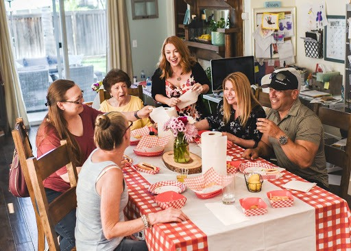 Family gathered at the table laughing