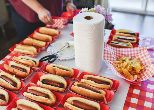 hot dogs on a table and paper towels
