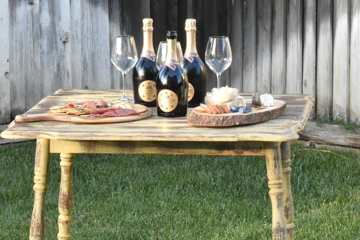 prosecco bottles with glasses and cheese boards