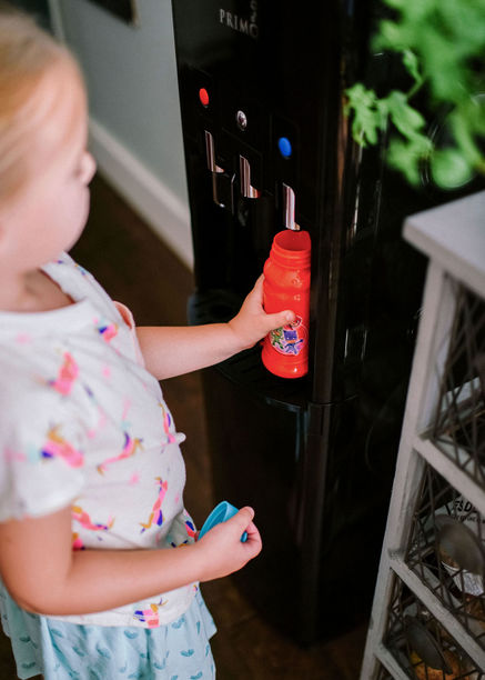 flking up a water bottle with the primo dispenser