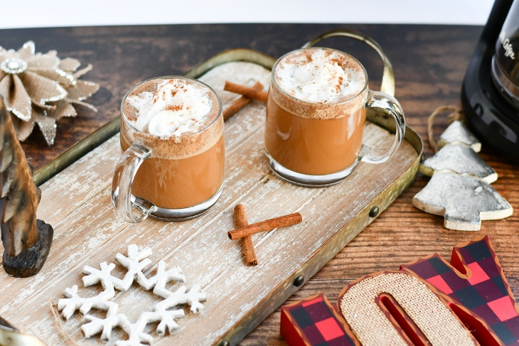 2 gingerbread lattes on a tray with ornaments