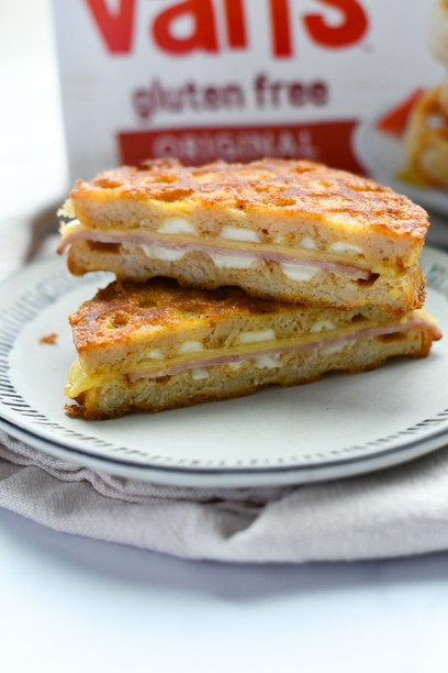 monte cristo sandwich on a plate with a box of waffles in the back